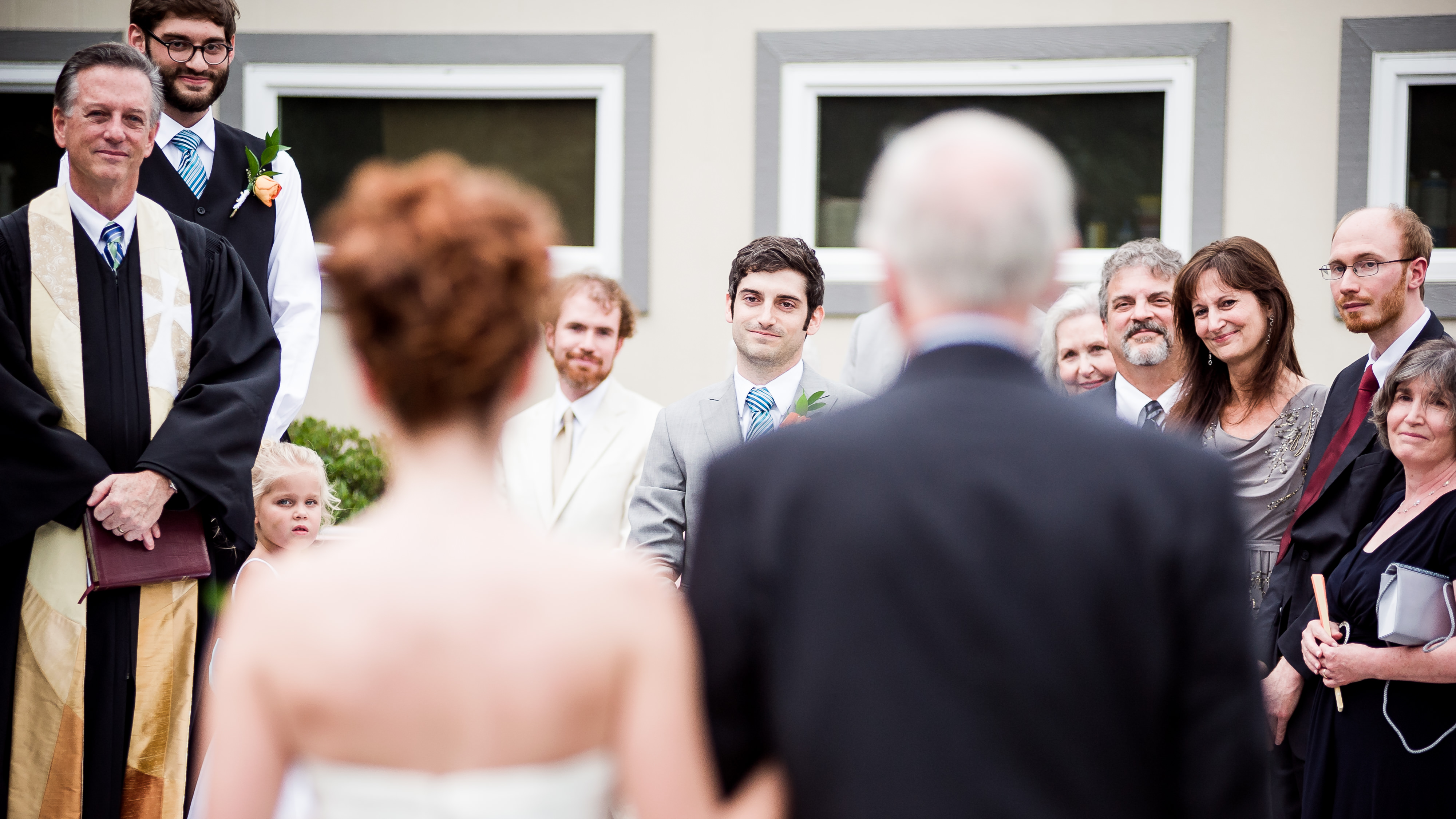 Sweet moment of groom seeing bride walk down the aisle
