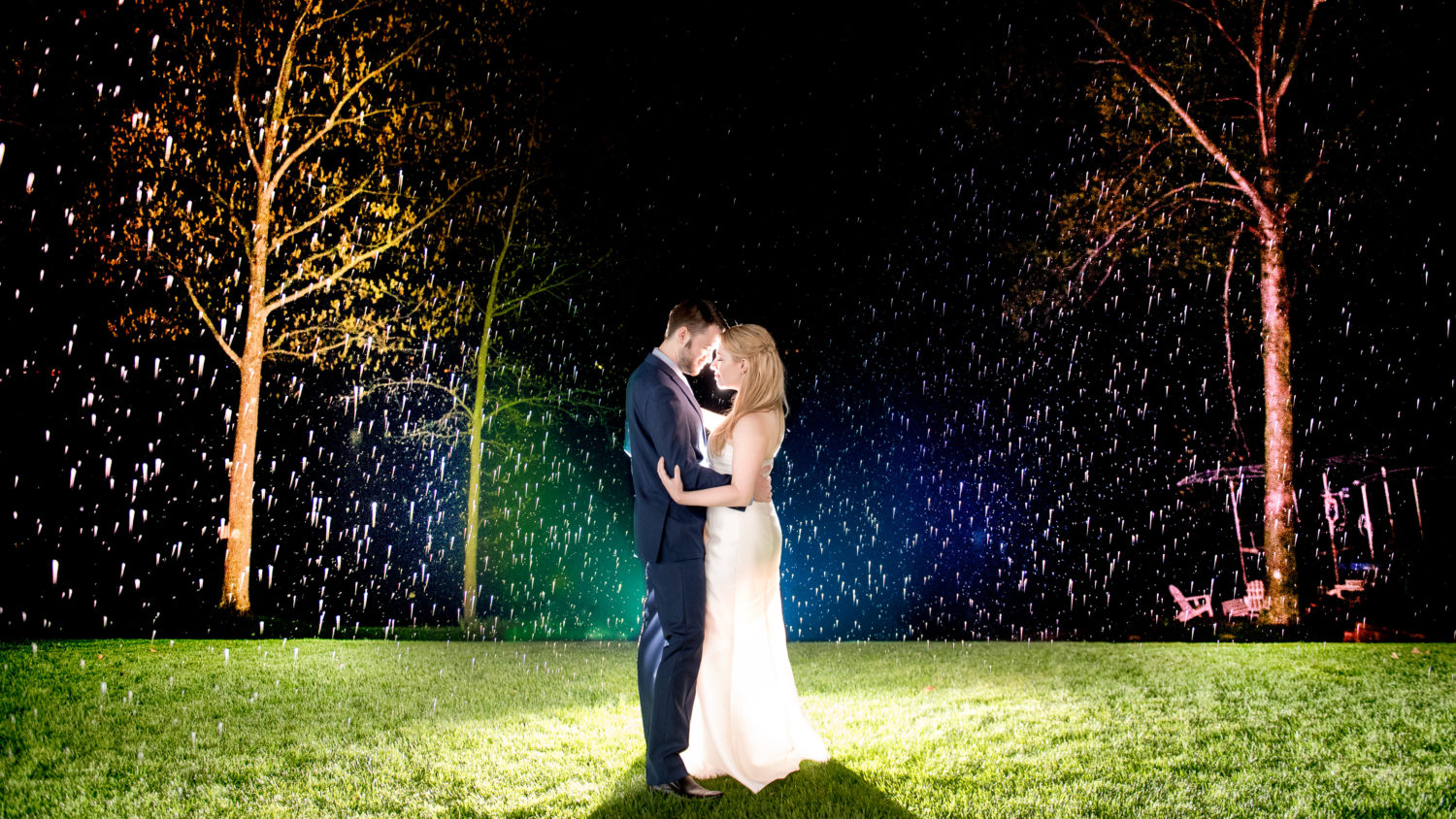 Rainbow rain backlit wedding portrait