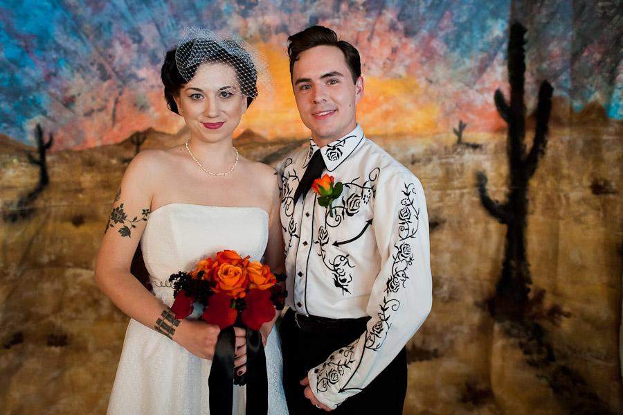 wedding portrait in front of DIY western backdrop
