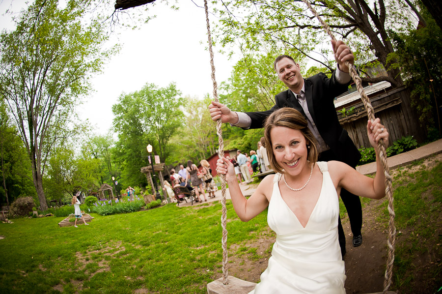 cute bride and groom on a swing at wedding