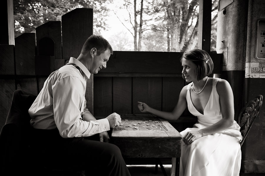 bride and groom playing checkers at story inn in brown county indiana