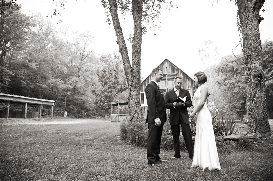 couple in front of barn at story inn wedding