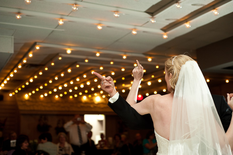 funny first dance photo of bride and groom pointing fingers