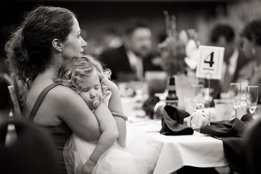 fun photo of a sleepy girl at a wedding