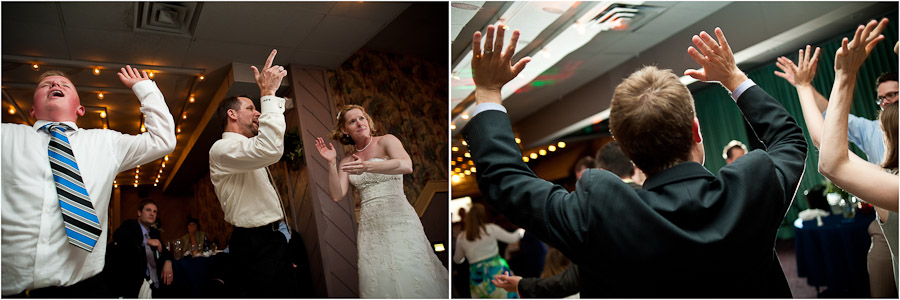 raising hands while dancing at wedding