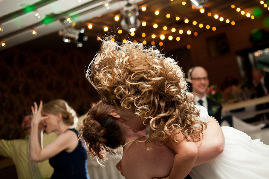 cool photo of hair flying while dancing at wedding