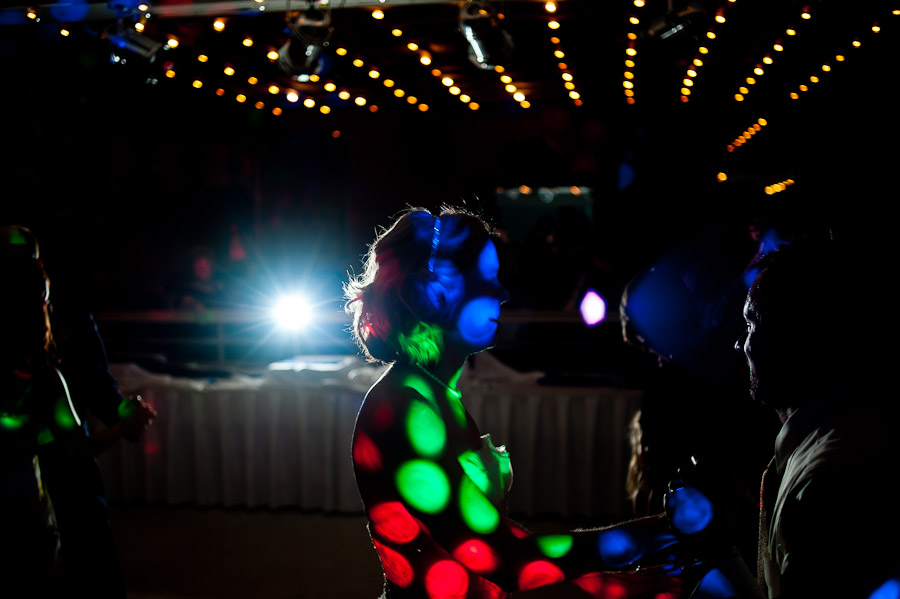 hilarious quirky photo of bride covered by DJ lights