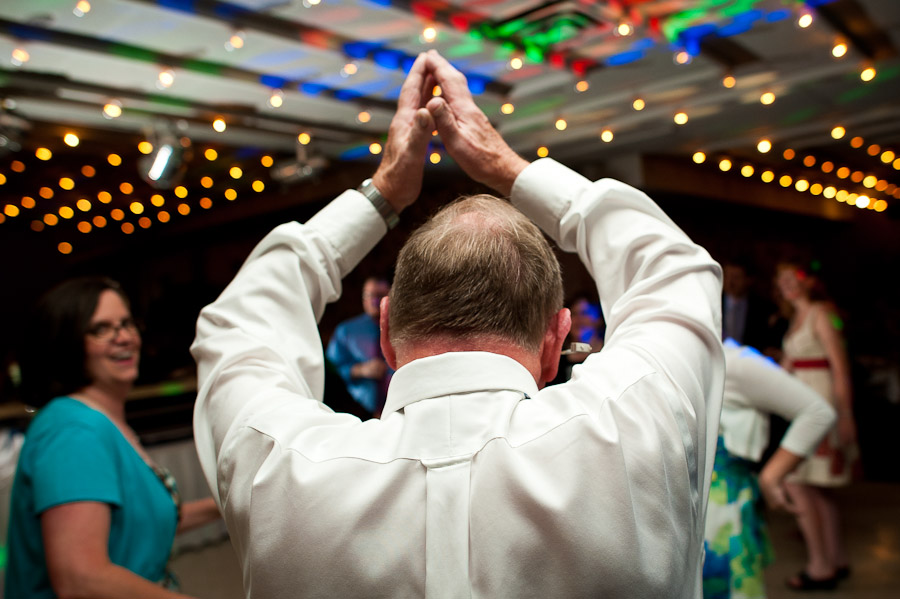 father of groom walking like an egyptian at wedding in bloomington