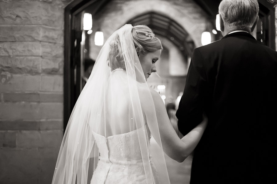 bride waiting with father before walking down aisle
