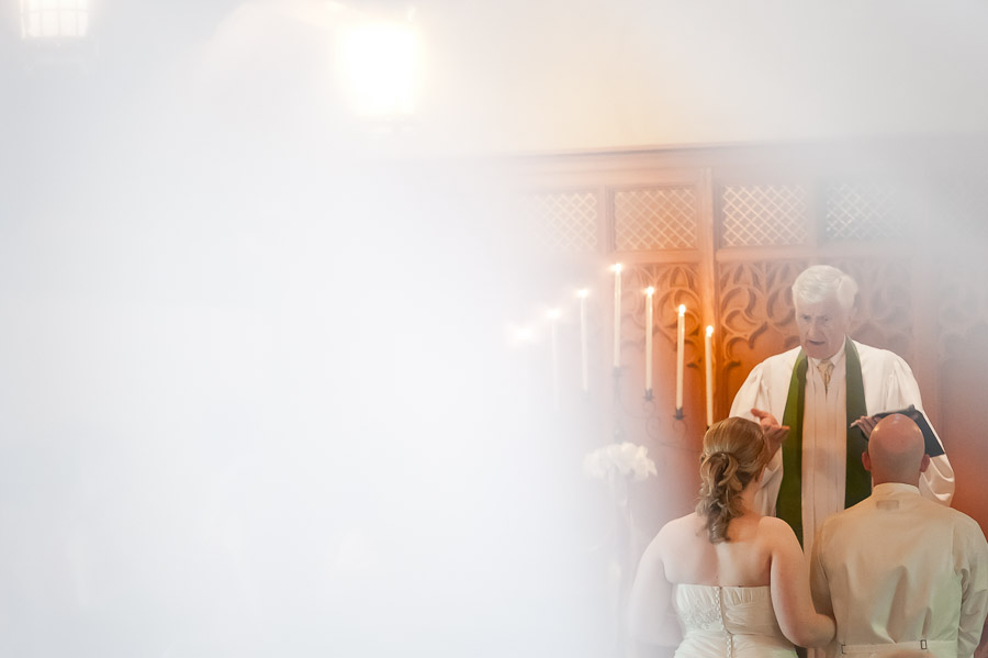 bride and groom in beck chapel during ceremony