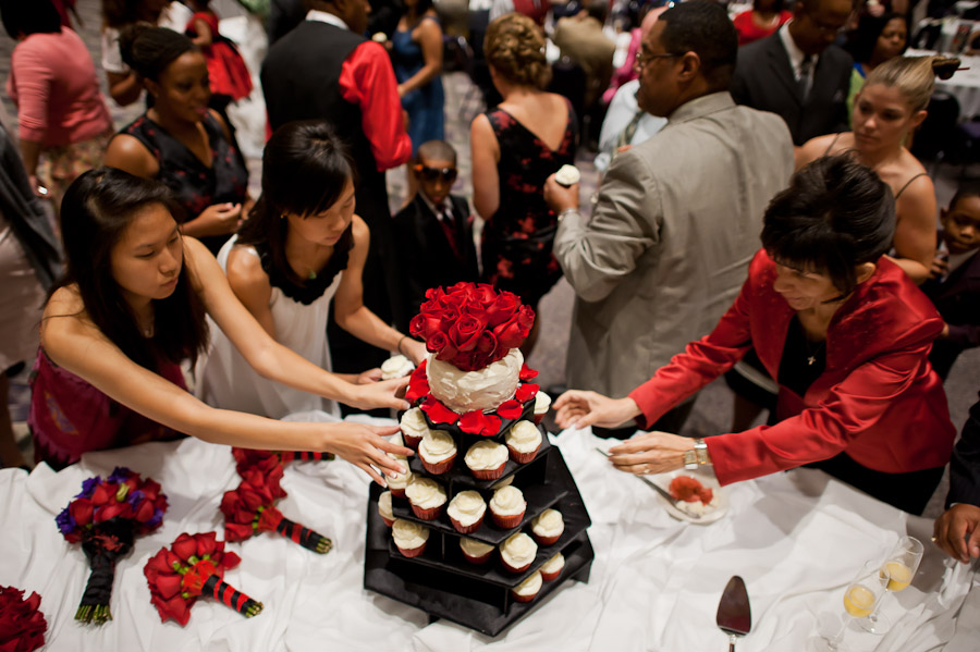 funny wedding moment of people grabbing cupcakes