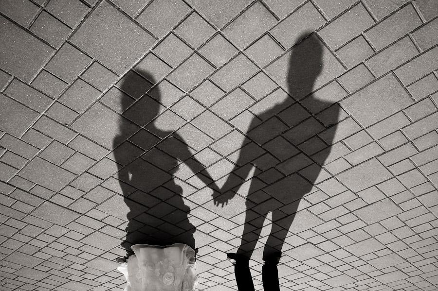 Creative wedding portrait of shadows and bricks