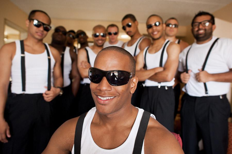 Groomsmen in sunglasses and suspenders