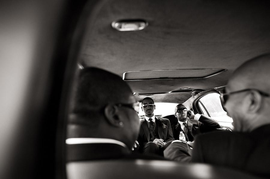Groom and groomsmen in limo before wedding