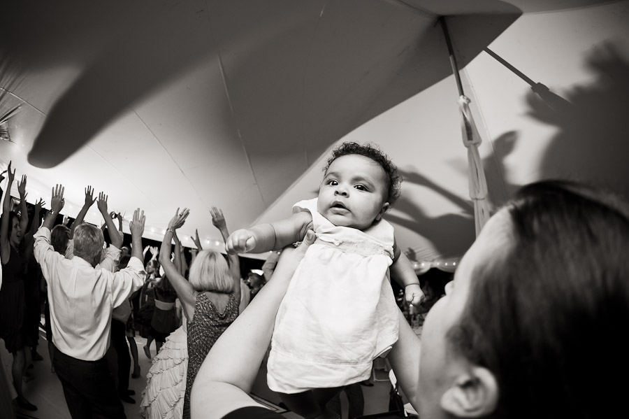 adorable baby dancing at wedding reception