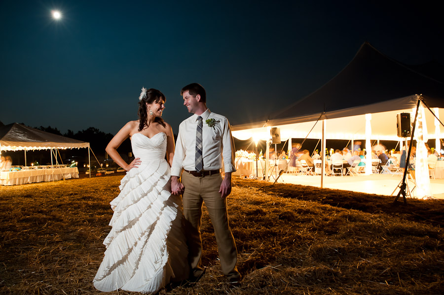 cool long exposure outdoor portrait of bride and groom at night