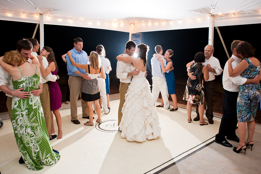 sweet moment during slow dance with bride and groom