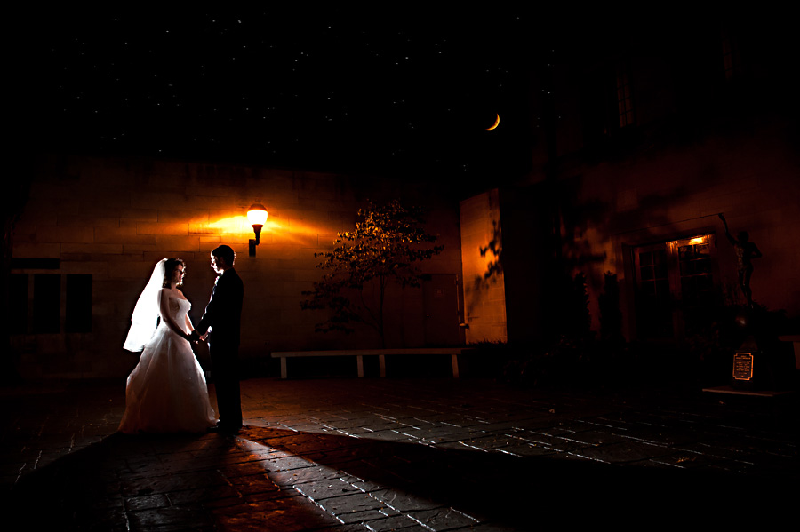 Moonlit nighttime portrait of wedding couple bride and groom at Indiana Memorial Union in Bloomington Indiana