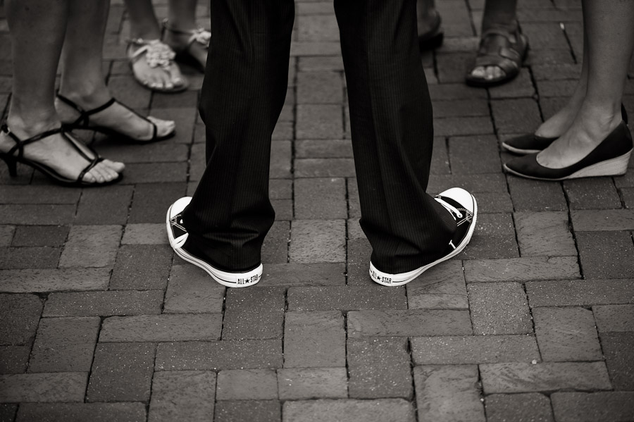 funny candid photo of shoes at wedding