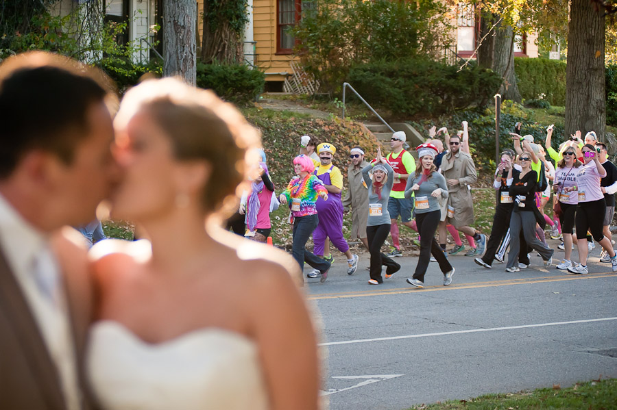 Funny Wedding Photo with Beer Run in background
