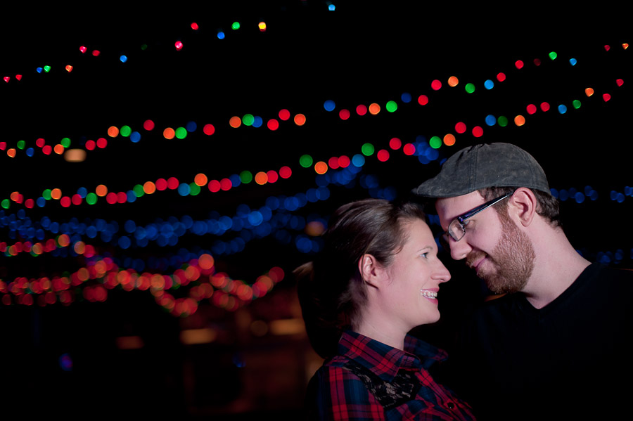 Sweet engagement photo at Bloomington Atlas Bar