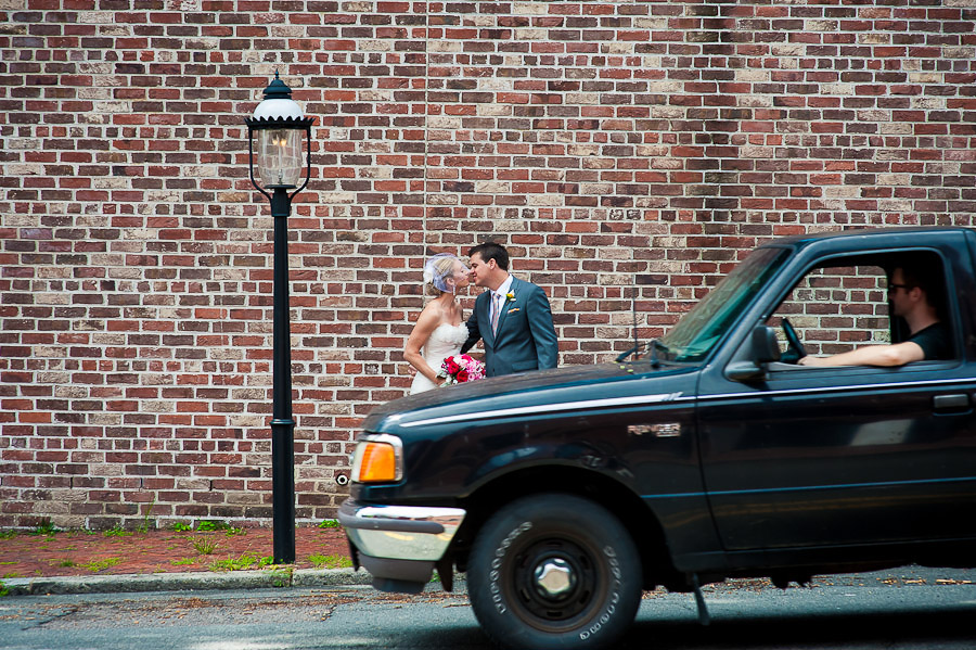 Funny portrait of bride and groom with passerby in car
