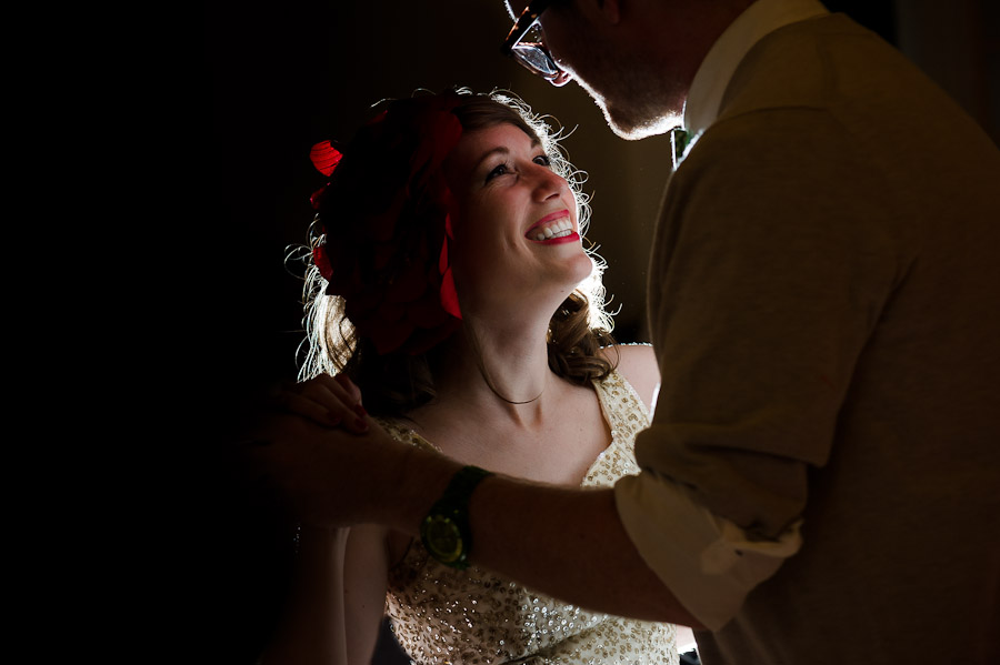 Dramatic dancing portrait of bride and groom at wedding reception