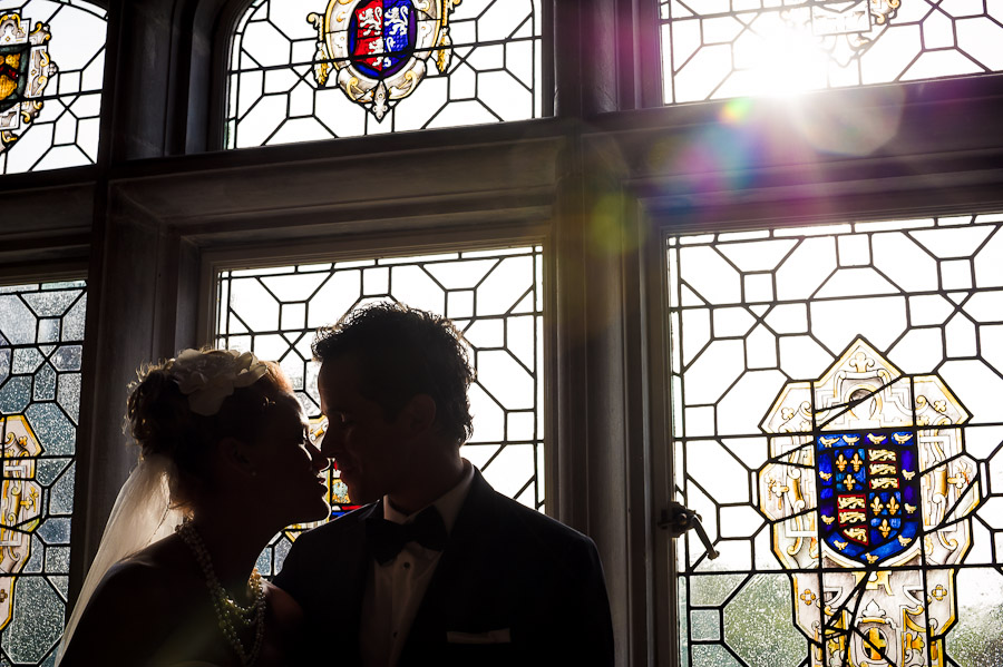 Romantic, sun flare portrait with stained glass at Laurel Hall