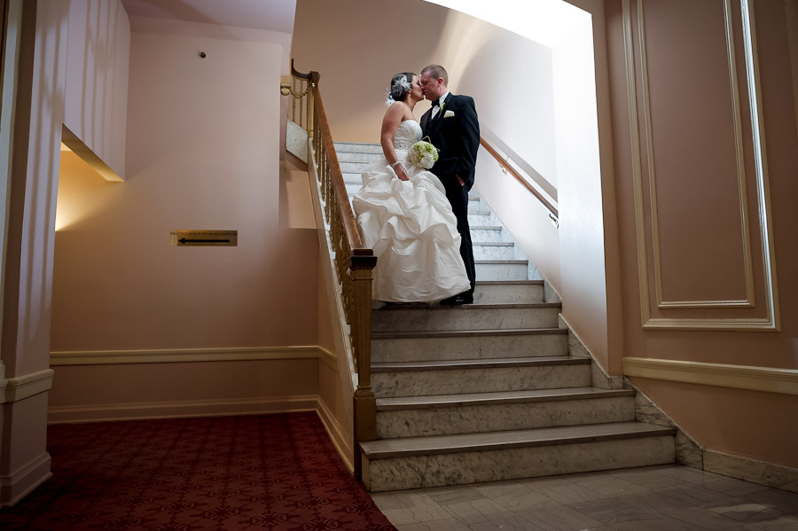 Romantic, architectural photo of bride and groom