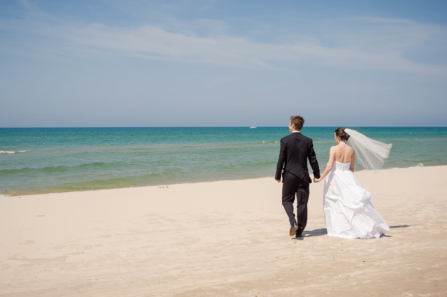 Bride and groom on beautiful, picturesque Lake Michigan