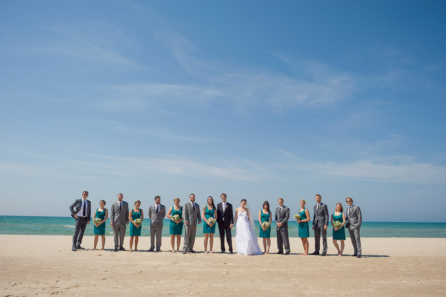 Quirky and colorful bridal party photo on beach at Lake Michigan