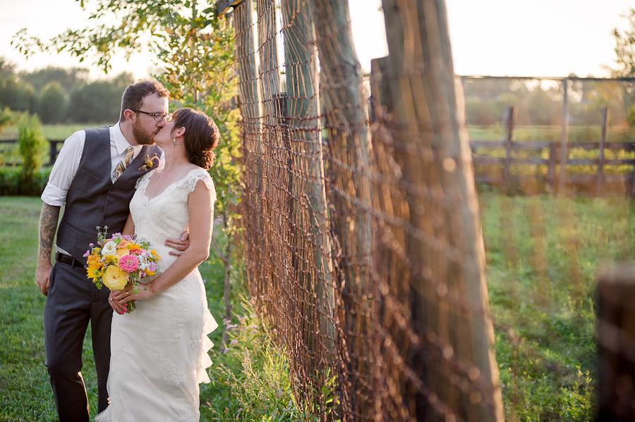 beautiful wedding photo of stylish bride and groom at farm wedding