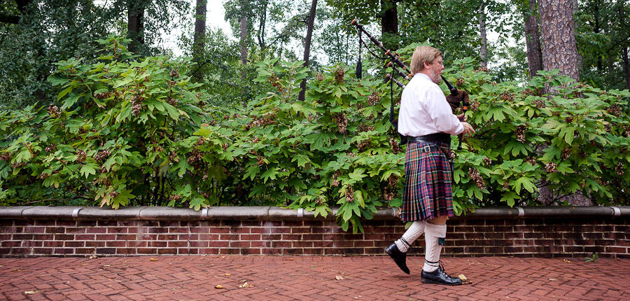 Sweet bagpiper piping at destination wedding