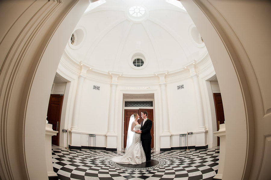 Gorgeous wedding couple in domed cathedral with checkered floor