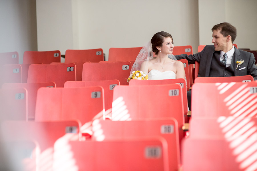 quirky and fun photo of wedding couple in classroom on Indiana University campus