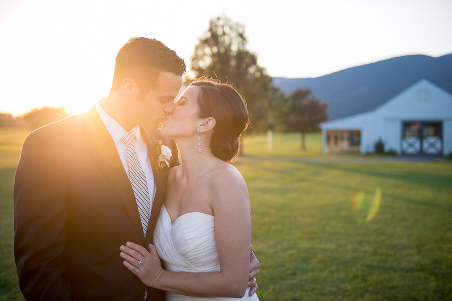 Breathtaking, sunny smooch photo at Charlottesville, VA wedding