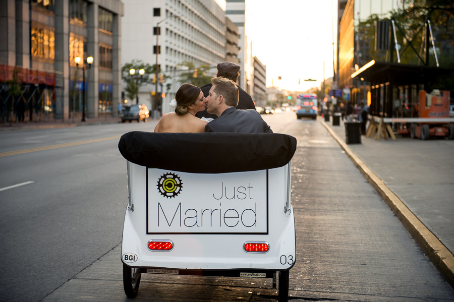 Romantic sunset kiss on pedi-cab in downtown Indianapolis