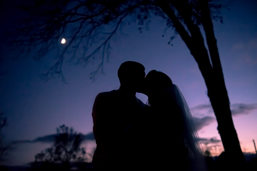 Gorgeous, artistic, sunset wedding silhouette portrait of bride and groom