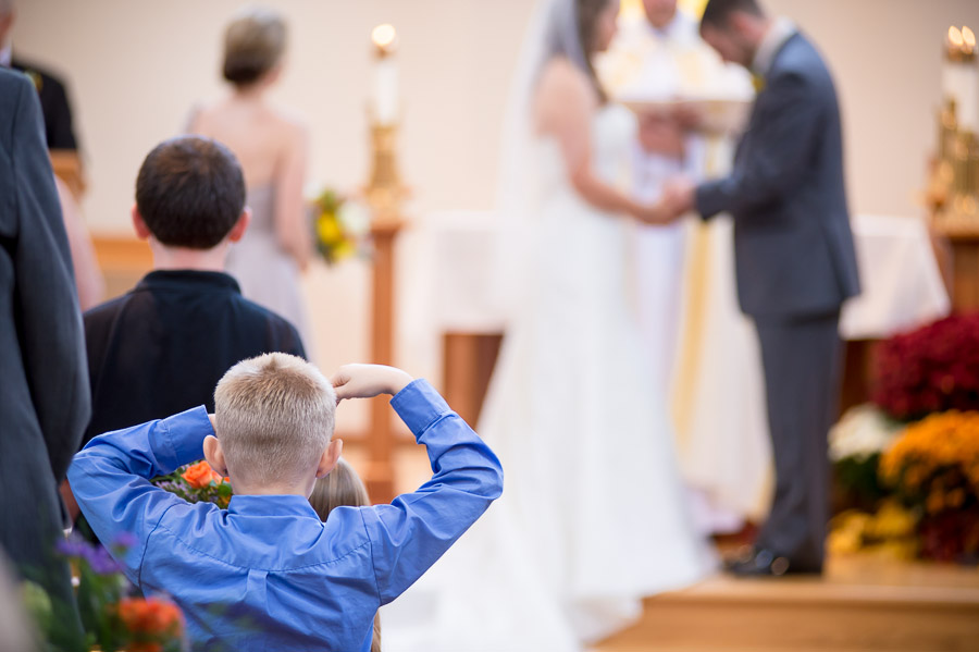 Pic of funny, cute kid watching wedding ceremony in Brown County Indiana