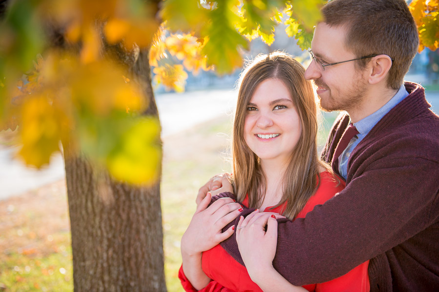 Lovely fall engagement photo under tree