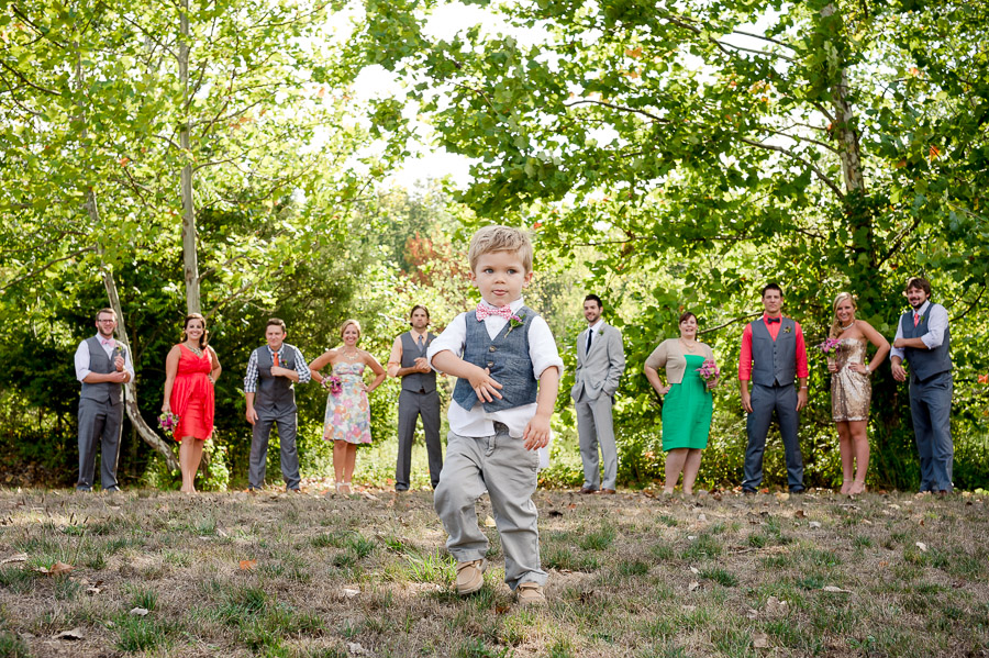 funny kid in wedding bridal party photo