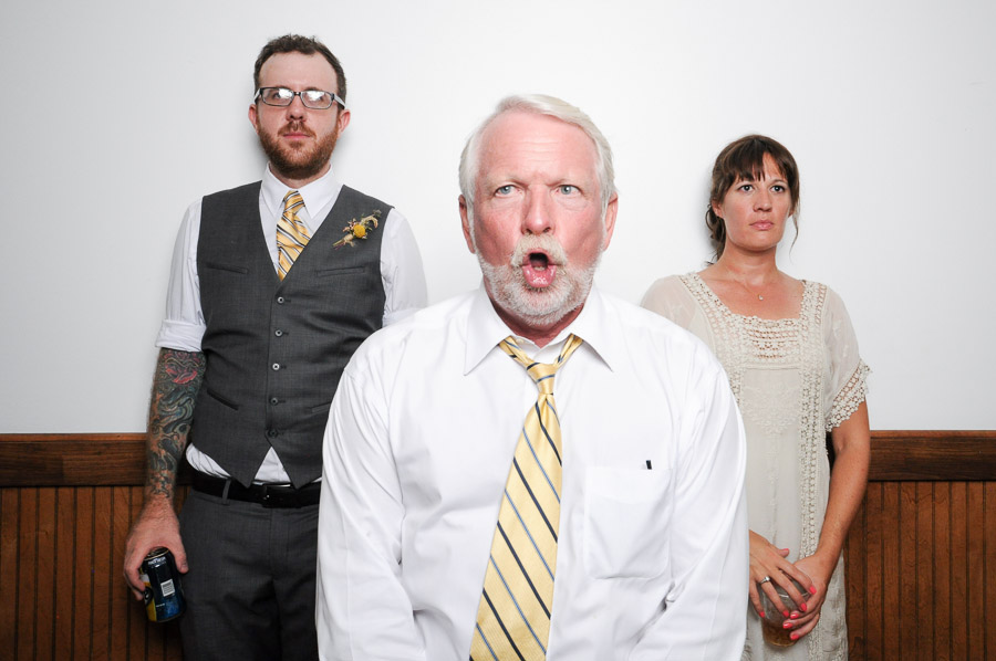 hilarious of bridal couple and officiant photobooth picture at Louisville wedding