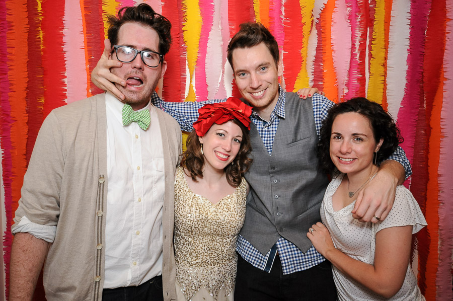 Fun and bright colors in photobooth at creative and unique wedding