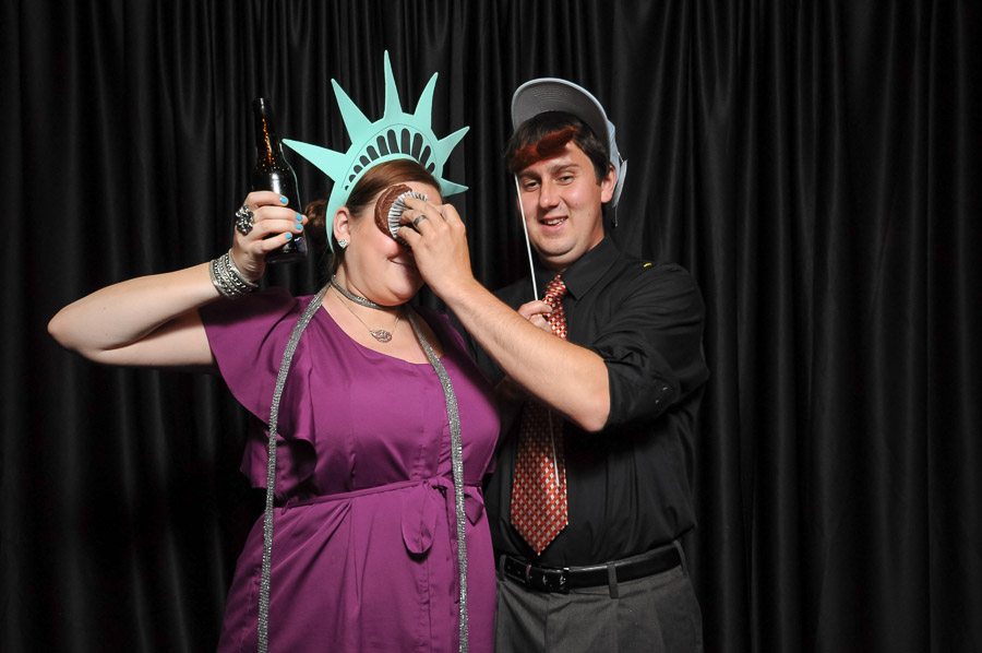 Funny couple in Indianapolis photobooth pic with smashed cupcake