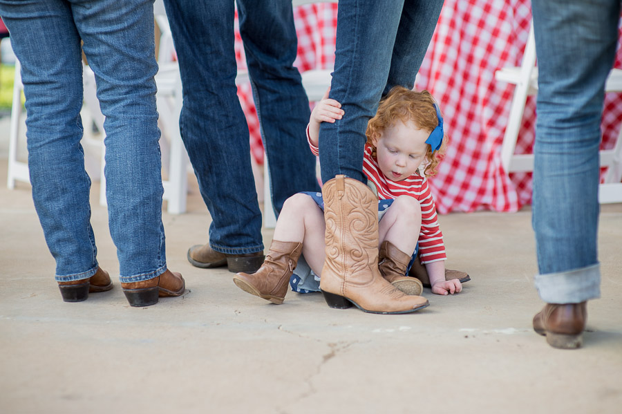 Cute, funny, kid portrait at casual BBQ wedding rehearsal dinner