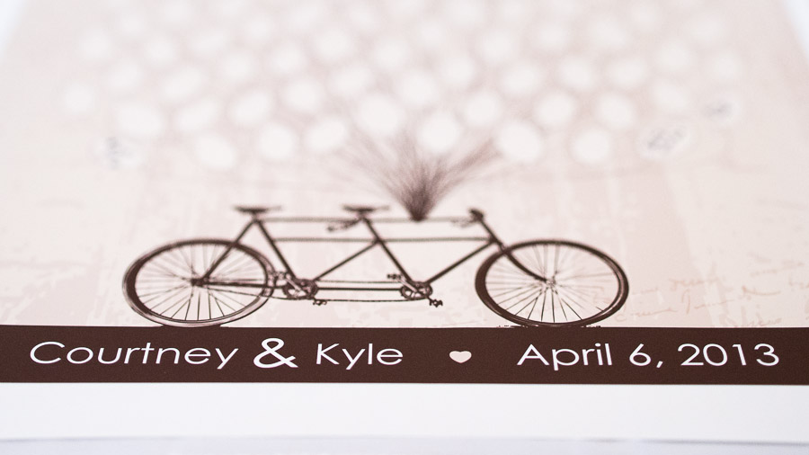 Artsy tandem bike sign in table at Indiana wedding