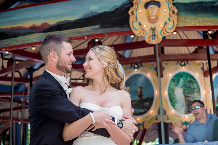 Funny passerby on carousel during wedding portrait