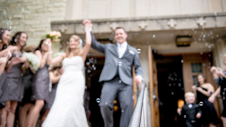 Artistic, classy wedding exit photo moment with bubbles in Indy
