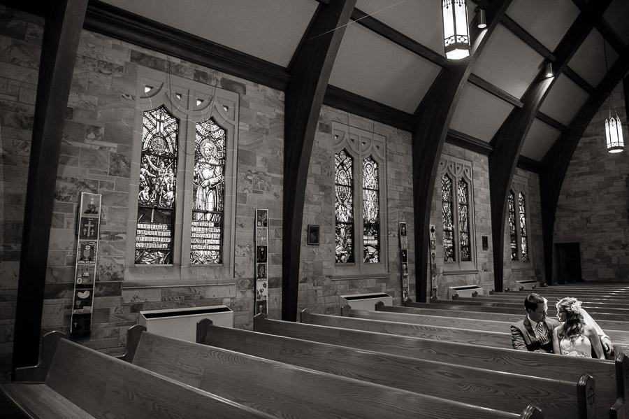 romantic, quiet wedding moment in sanctuary of Immaculate heart of st. mary in Indiana