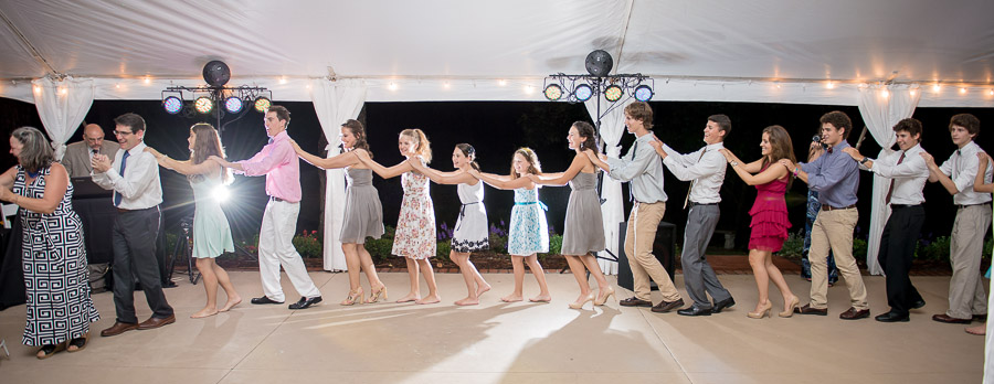 fun and creative conga line photo at whitford plantation wedding